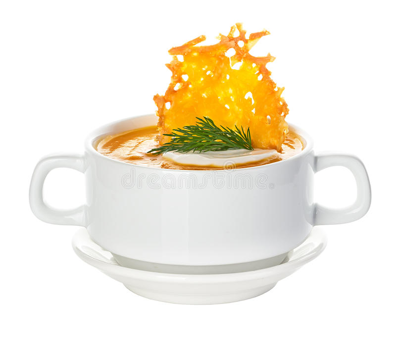 Cream of pumpkin soup with parmesan crisps royalty free stock photos