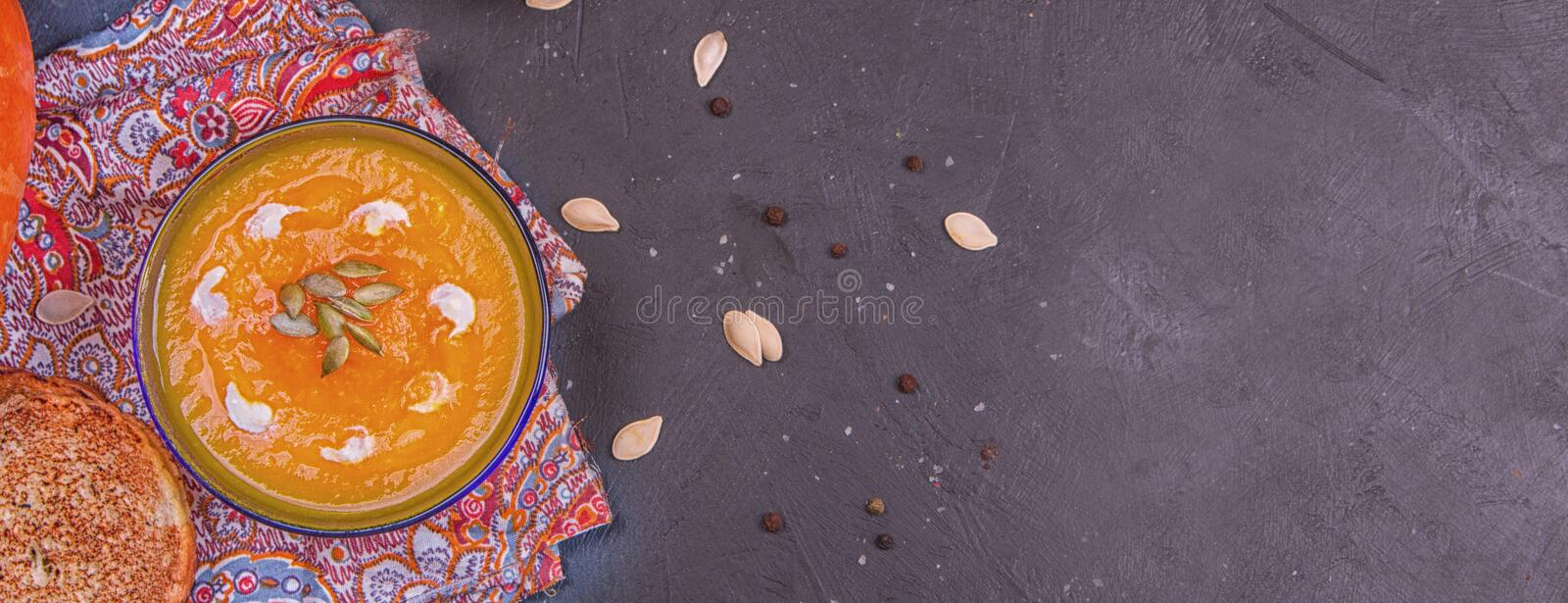 Cream of roasted pumpkin spicy soup traditional simple vegetarian autumn vegetable healthy organic diet homemade food meal on royalty free stock photos