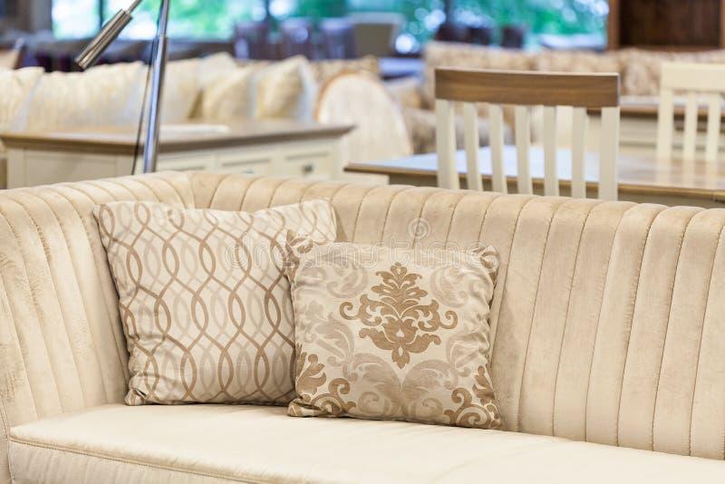 Cream sofa. A cream velvet sofa with embroided pillows royalty free stock photos