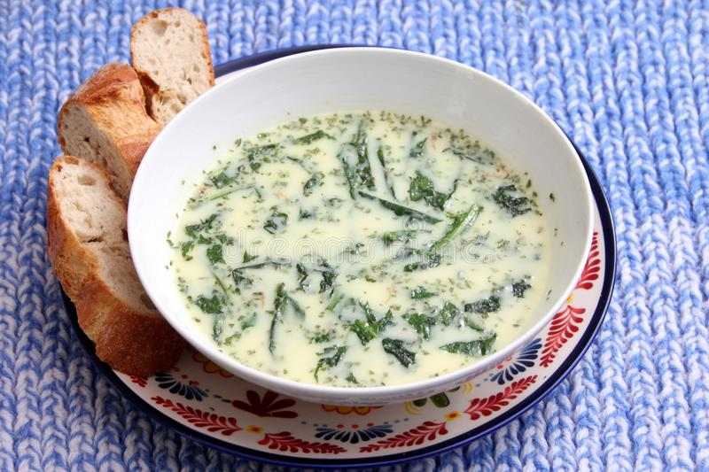 Cream soup with dandelion royalty free stock photography