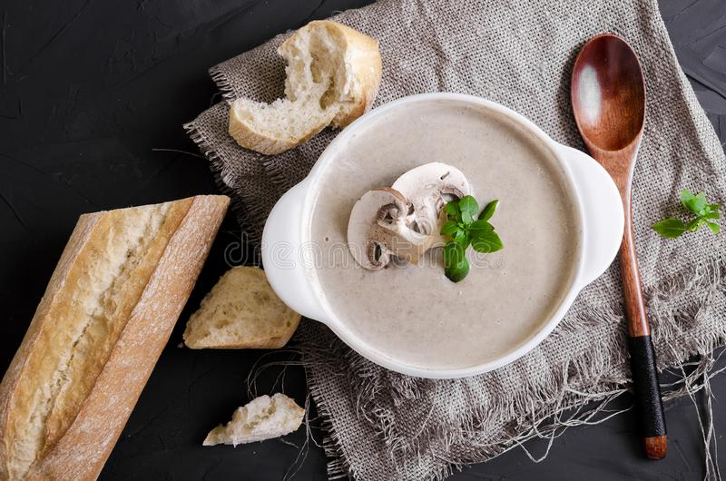 Cream soup made from mushrooms with bread. Cream soup made from mushrooms with crispy bread and oregano on black phone royalty free stock photo