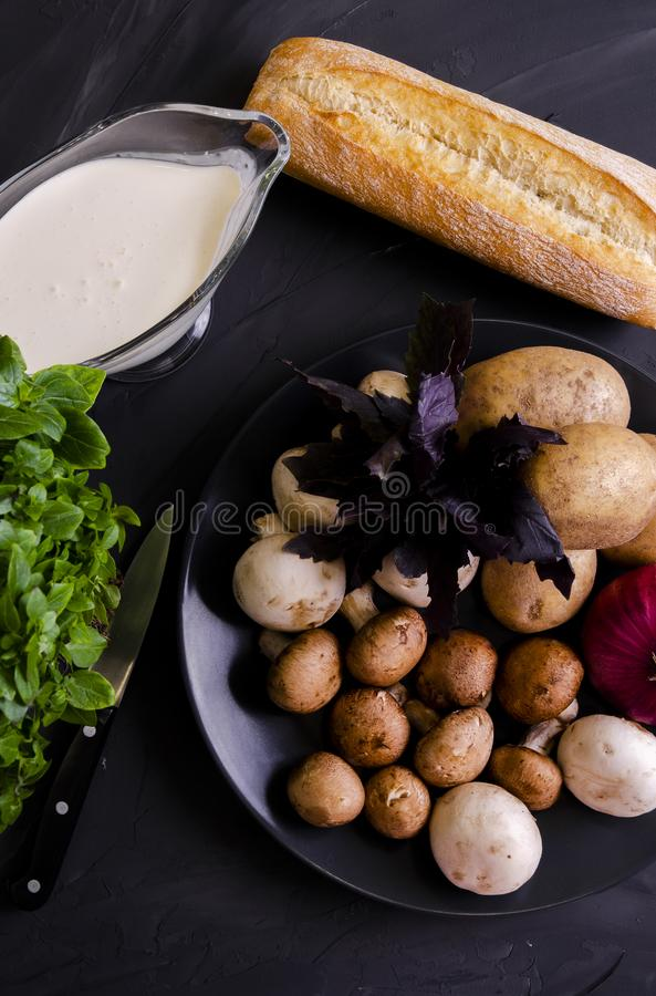 Cream soup made from mushrooms with bread. Cream soup made from mushrooms with crispy bread and oregano on black phone royalty free stock image