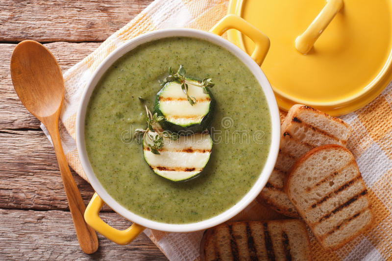 Cream soup of zucchini with herbs close-up in a saucepan. horizontal top view royalty free stock photos