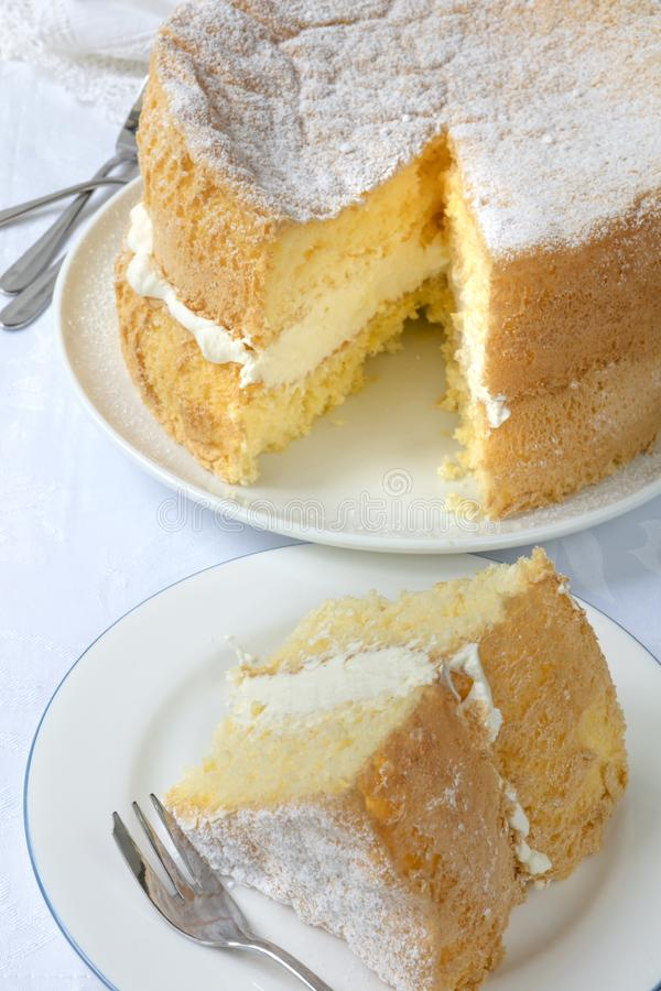 Download Cream Sponge Cake With Slice Cut Out For Serving Stock Photo - Image of cake, plates: 108555620