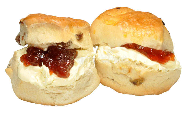 Cream And Strawberry Jam Scones. Cream and strawberry jam filled scones, isolated on a white background stock image