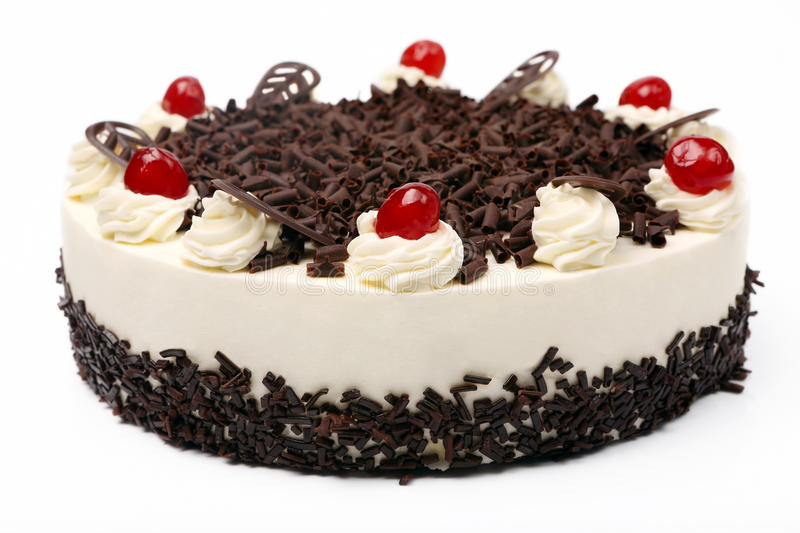 Cream vanilla cake with chocolate and cherries on white background.  royalty free stock photography