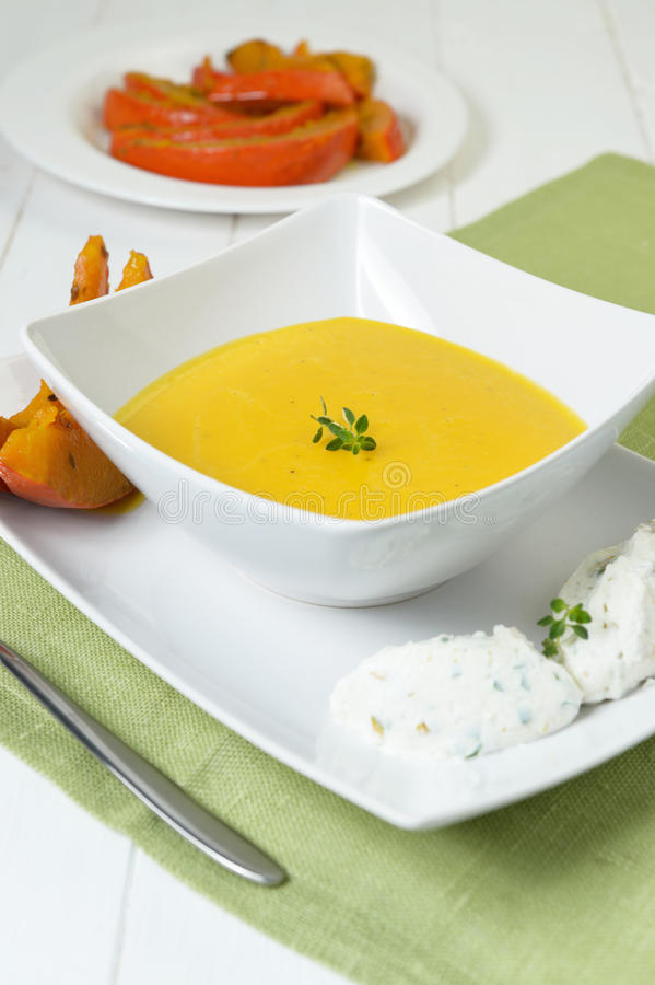 Creamed pumpkin soup. With ricotta royalty free stock image