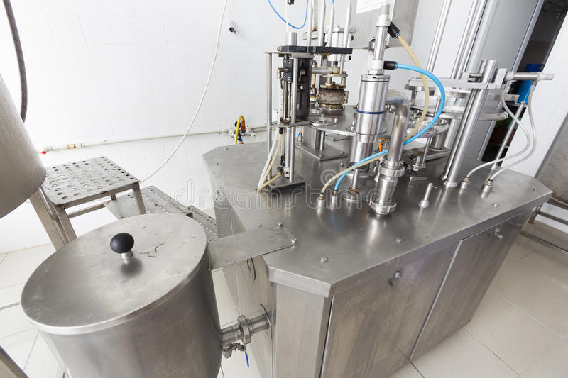 Creamery machine production device. Cheese production device in a small family creamery. The dairy farm is specialized in buffalo yoghurt and cheese production stock image