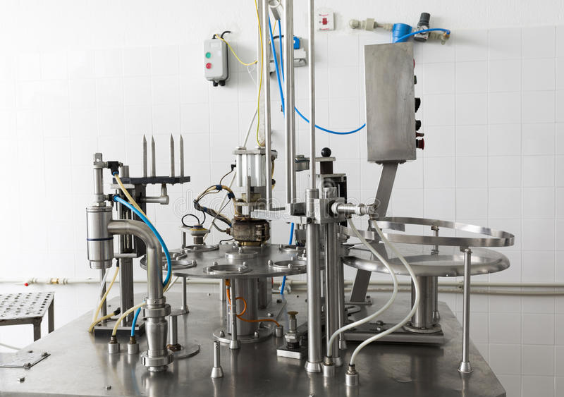 Creamery machine production device. Cheese production device in a small family creamery. The dairy farm is specialized in buffalo yoghurt and cheese production royalty free stock photo
