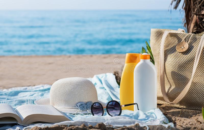 Creams for skin care of the sun on the beach. Space for tex royalty free stock photo