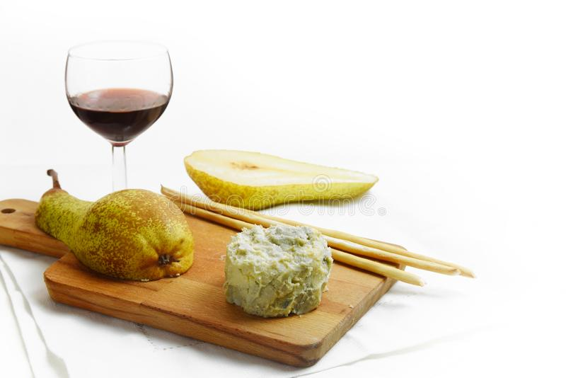 Creamy blue stilton cheese, port wine, pears and cracker sticks stock images