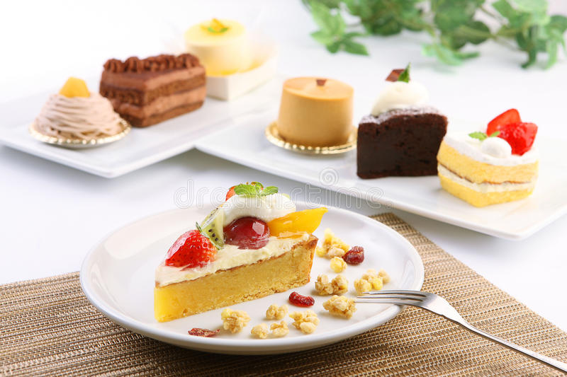 Creamy cake for dessert with strawberry, kiwi and mango on white stock images