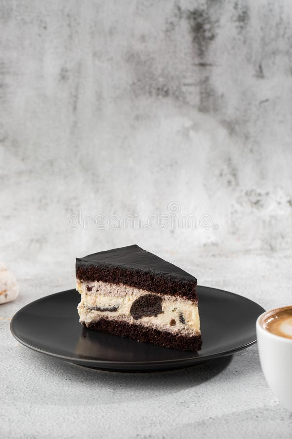 Creamy cheesecake with chocolate cookies and cream biscuits, chocolate cookies and cream biscuits cheese cake. Piece of cake on royalty free stock photo