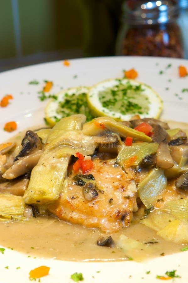 Creamy chicken and artichoke dish royalty free stock photos