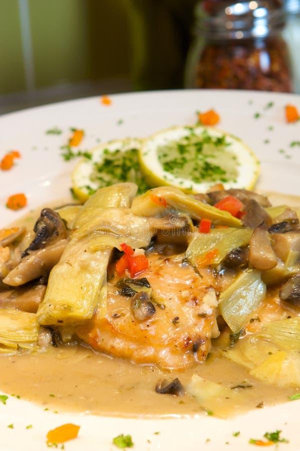 Creamy chicken with artichokes stock image