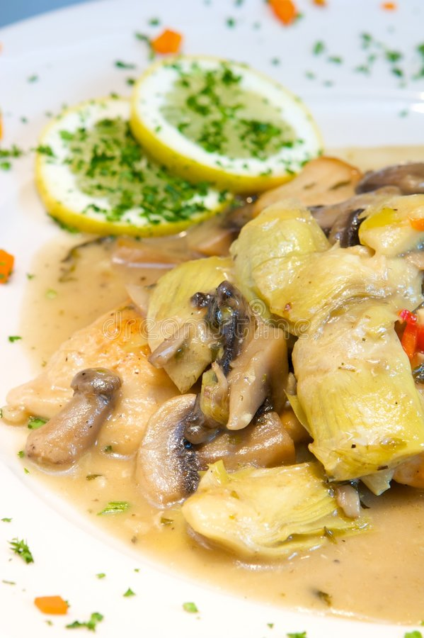 Creamy chicken with artichokes and mushrooms royalty free stock photography