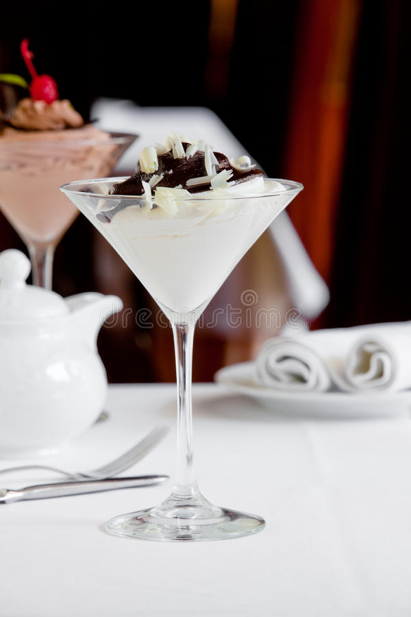 Creamy dessert. With chocolate on table royalty free stock photos