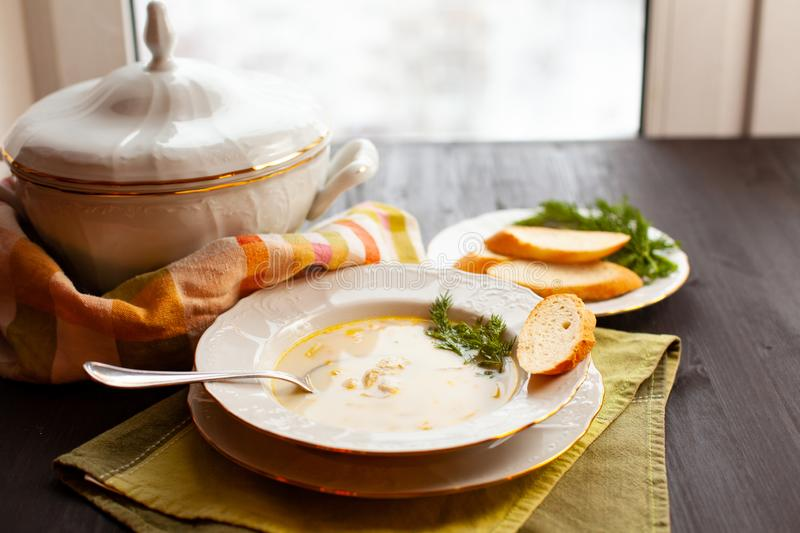 Creamy fish soup with salmon, potatoes and dill stock photo