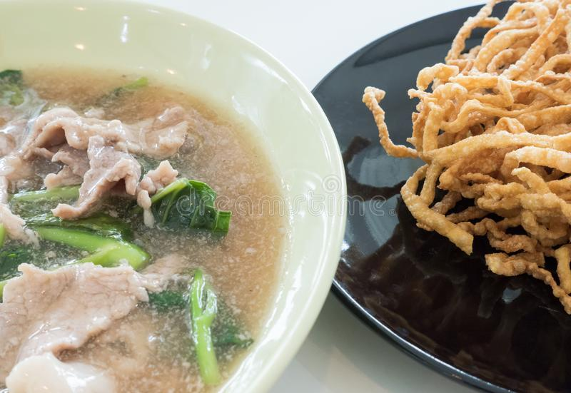 Creamy gravy Sauce with pork and crispy yellow noodle. royalty free stock photo