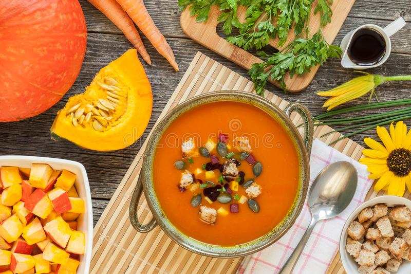Pumpkin soup in a bowl with Ingredients royalty free stock photography