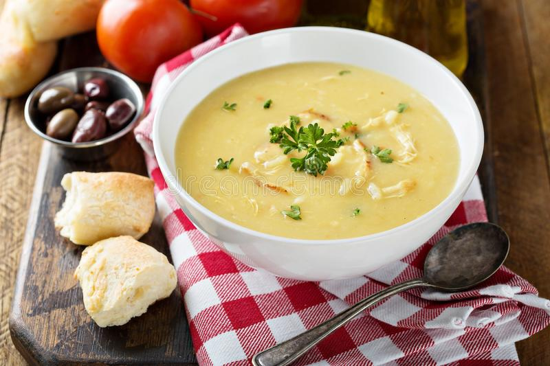 Creamy lemon chicken soup. With rice garnished with parsley royalty free stock photo