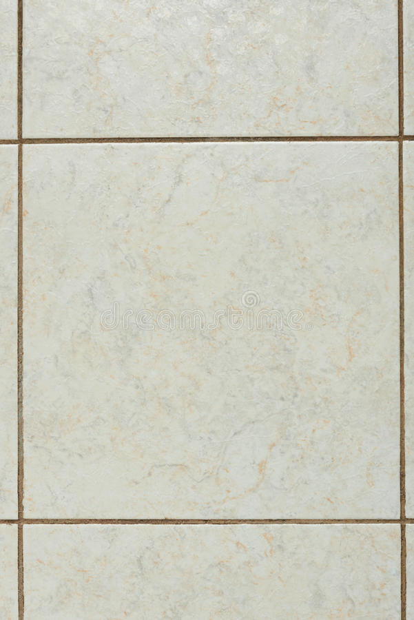 Creamy marble tile. Creamy surface marble square tile. One square abstract beige background royalty free stock photography
