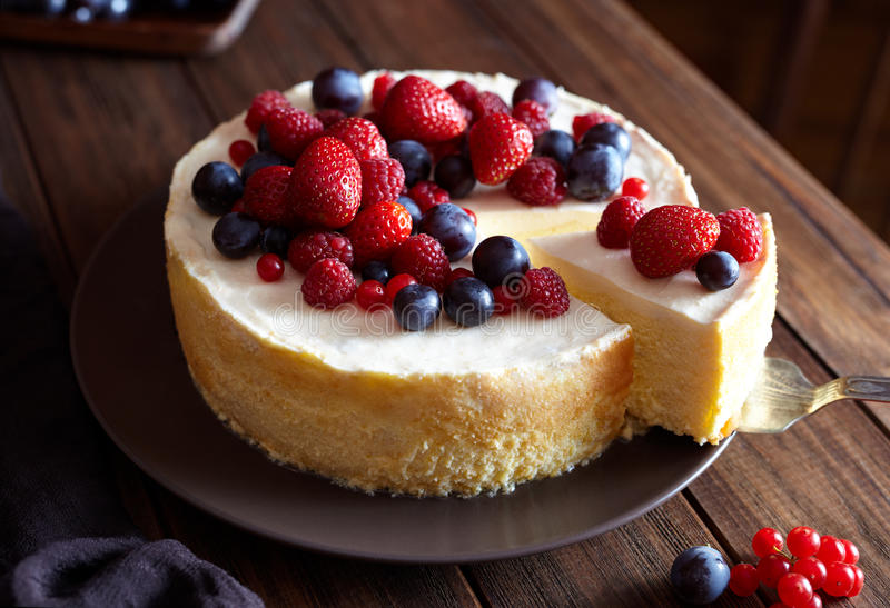 Creamy mascarpone cheese cake with strawberry and winter berries. New York Cheesecake. Close up. royalty free stock photos