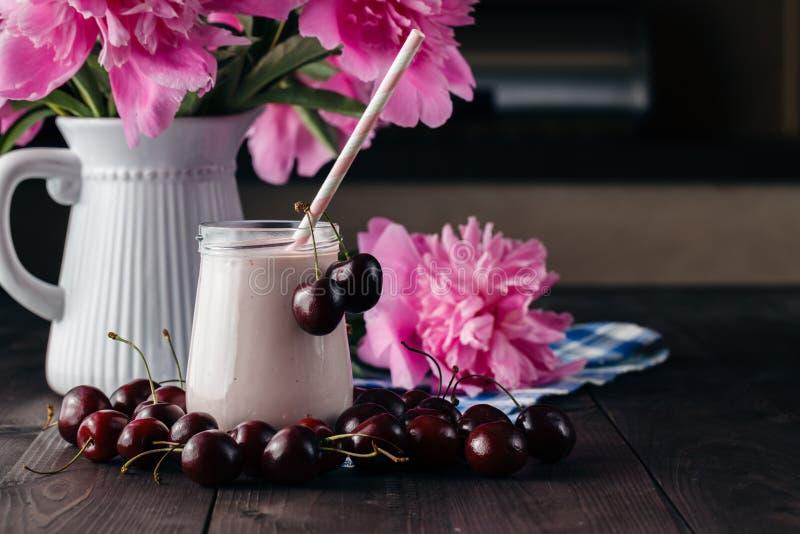 Creamy milk shake with fresh cherries royalty free stock photo