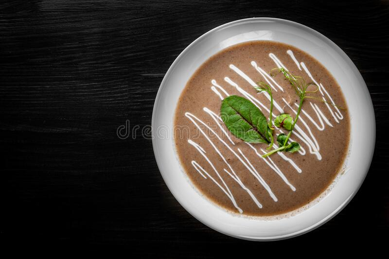 Creamy Mushroom Soup in a white plate stock photos