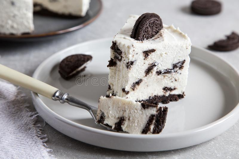Creamy no bake cheesecake with chocolate cookies. Biscuit cake royalty free stock photo