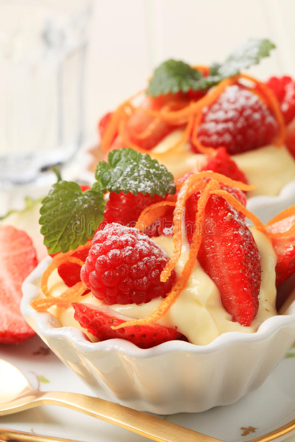 Creamy pudding and fresh fruit stock photography