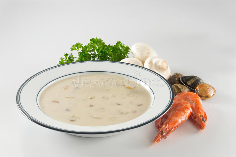 Creamy Seafood Soup. A plate of creamy seafood soup royalty free stock photography