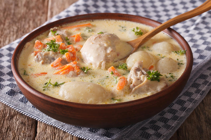 Creamy soup with chicken and vegetables close up in a bowl. horizontal stock photography