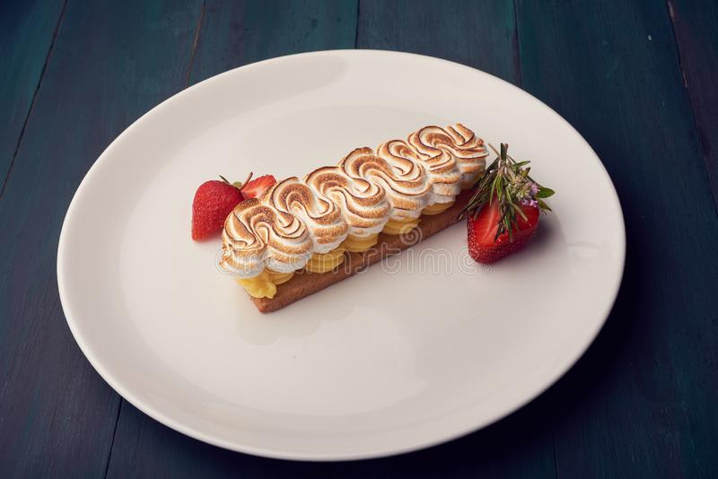 Creamy sweet dessert on a white plate royalty free stock image