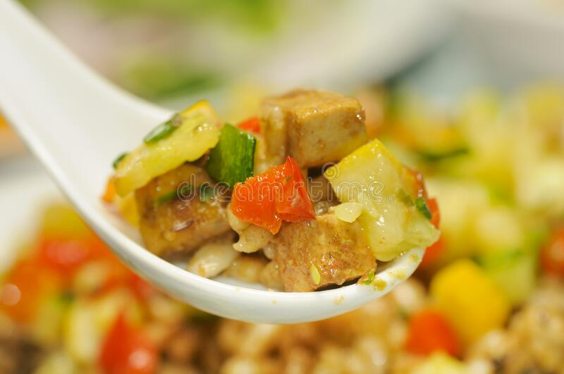 Creamy tofu with almonds, vegetables and barley royalty free stock photo