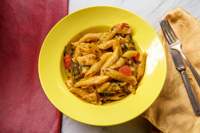 Creamy Tuscan Pasta Chicken royalty free stock image