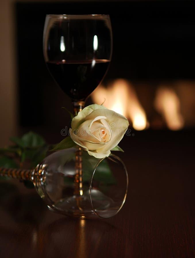 Creamy white rose with wine glass