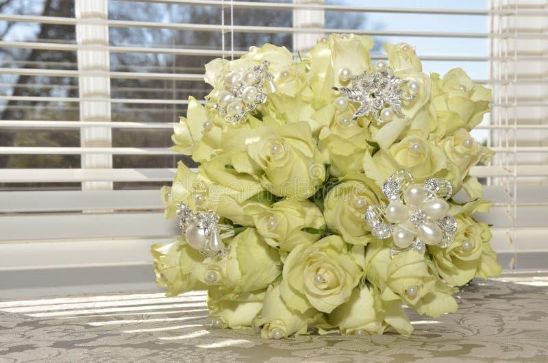 Creamy white wedding bouquet stock photo