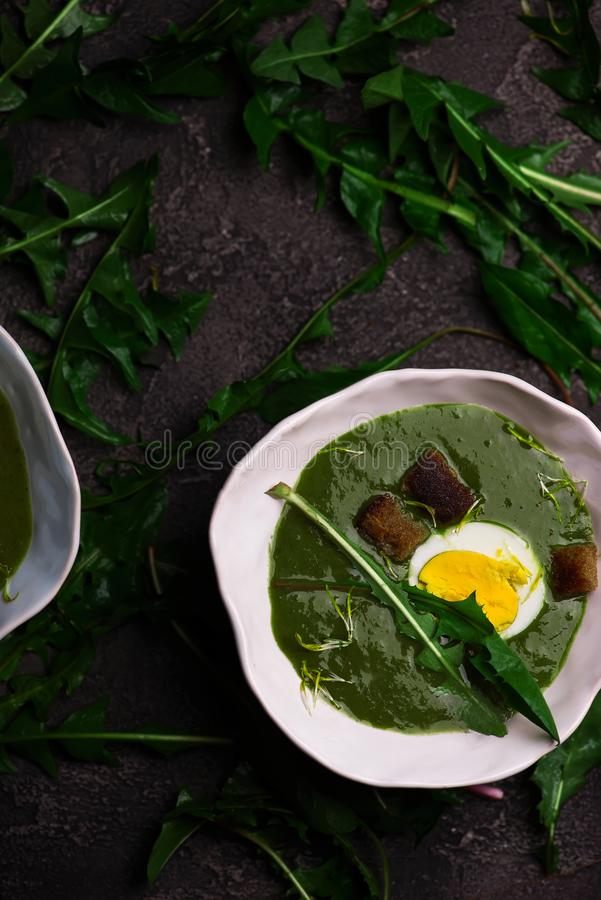 CREAMY WILD GARLIC SOUP WITH DANDELION LEAVES stock images