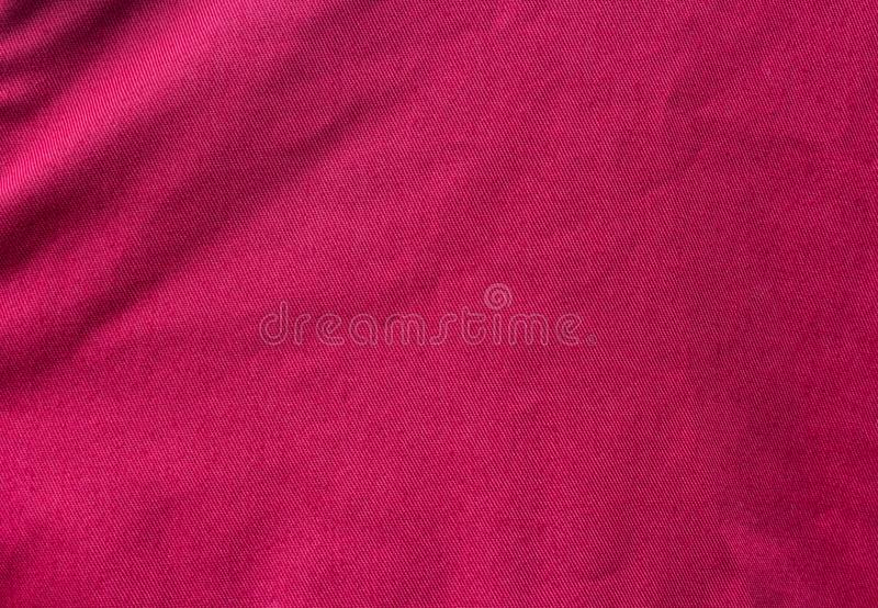 Crease on red fabric. Texture of crease on red fabric stock image