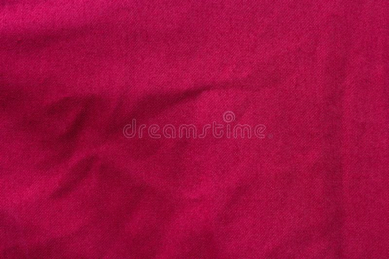 Crease on red fabric. Texture of crease on red fabric stock photo