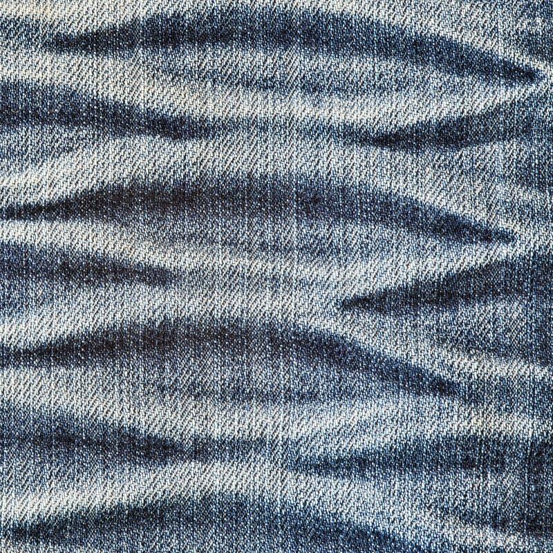 Creased denim surface