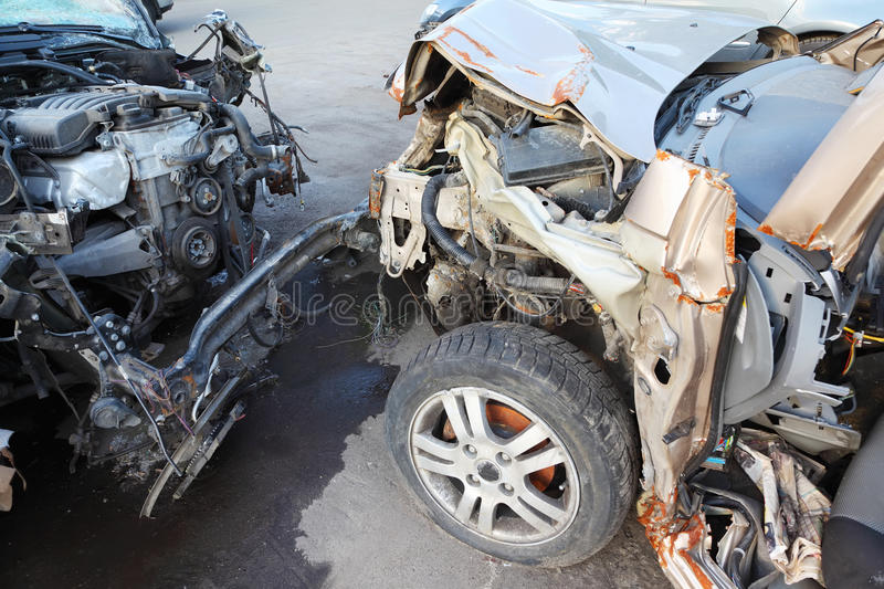 Creased hoods with bare motors of collided cars. Creased hoods with bare motors of two collided cars after horrible accident stock photography
