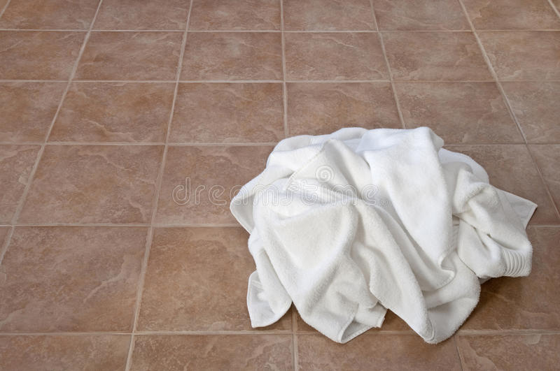 Download Creased White Towels On Ceramic Floor Stock Photo - Image: 22869944