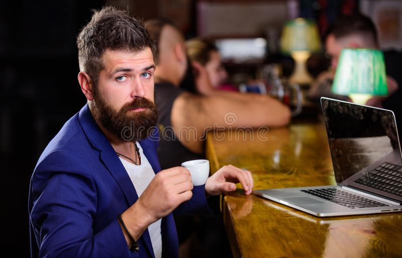 Create content web blog. Manager create post enjoy coffee. Hipster freelancer work online drinking coffee. Man bearded stock image