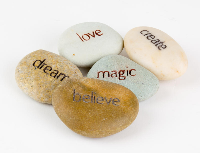 Create, magic, believe, dream, and love stones stock images