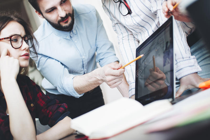 Create a new startup in an open loft space. Teamwork of young bu royalty free stock image