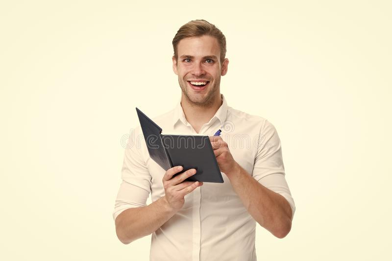 Create daily plan. Man office worker or manager cares about time management. Worker planning daily business schedule. Guy with notepad and pen noticing. Plan stock image
