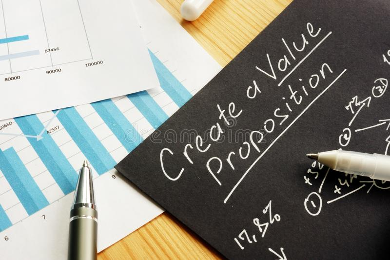 Create a Value proposition sign and business graphs royalty free stock photography