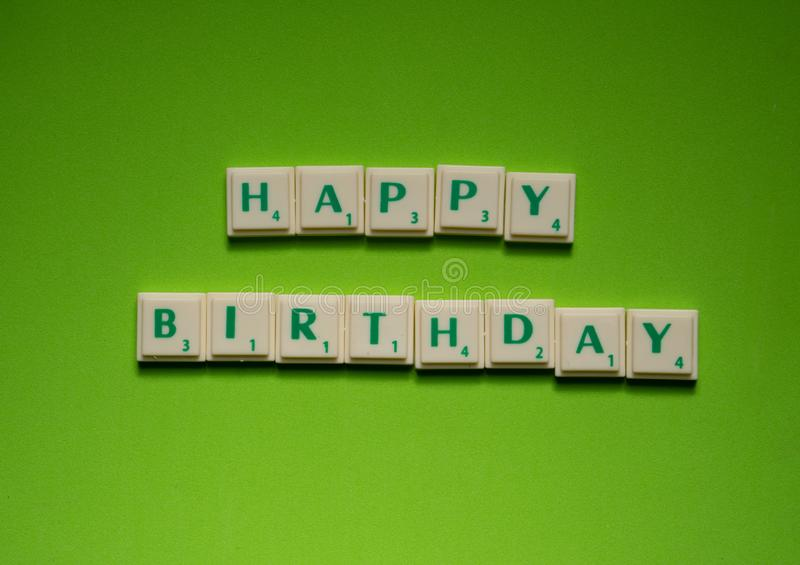 Created words of `Happy Birthday` on the green background royalty free stock image